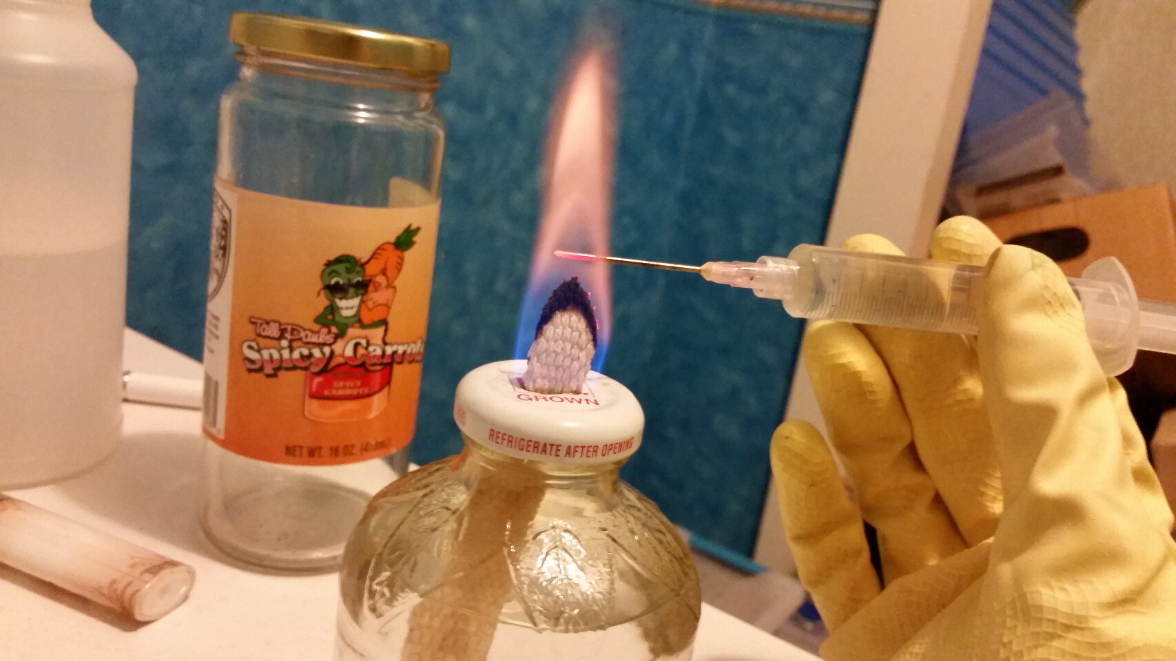 sterilizing flame with an alcohol wick